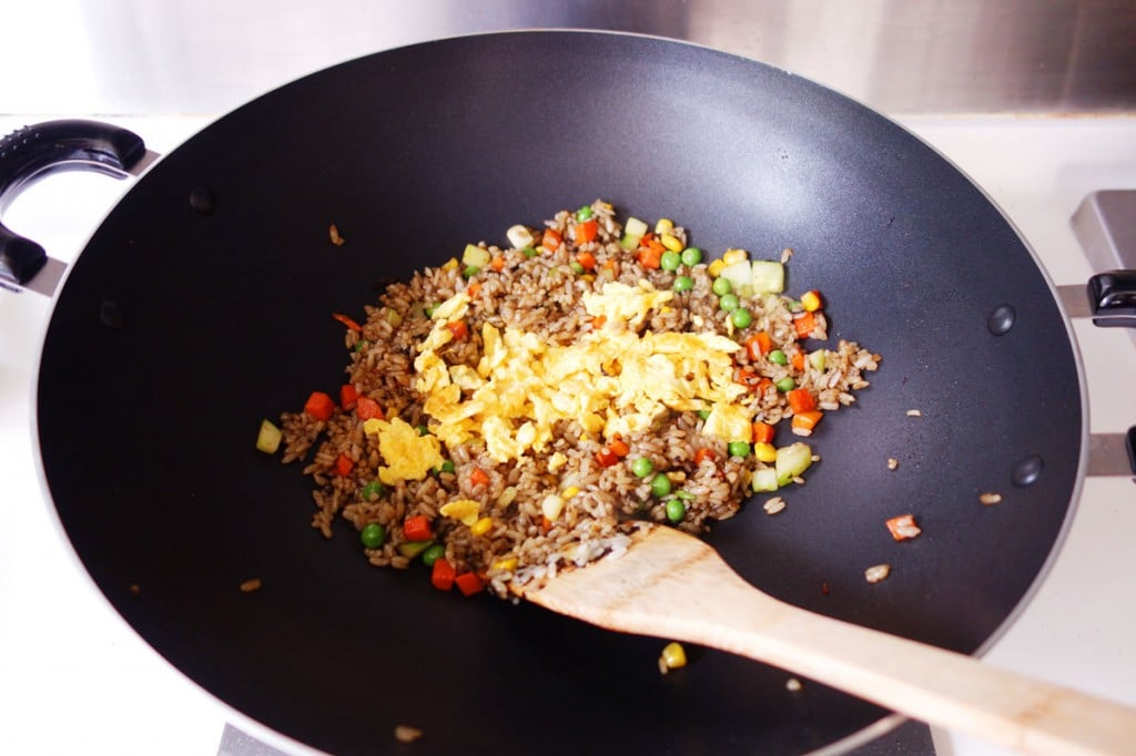 olive vegetable fried rice in a wok