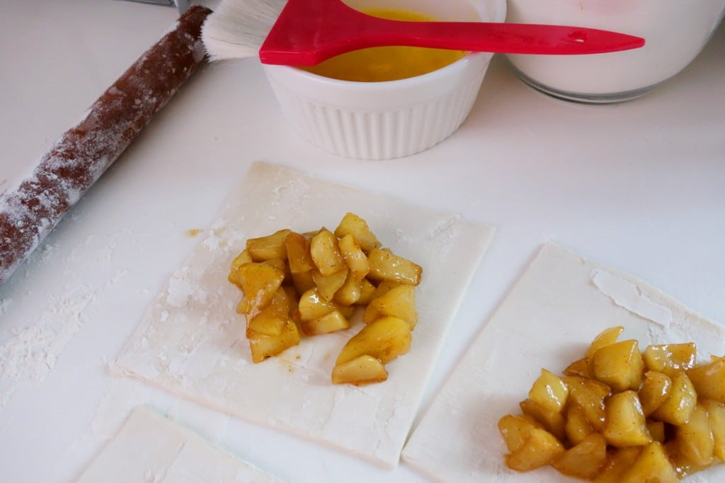 Filling the apple turnovers with cooked apples
