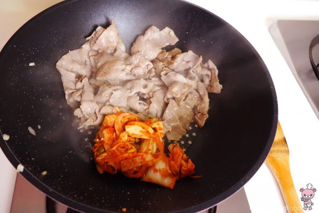 this is a photo of stir fry pork with kimchi