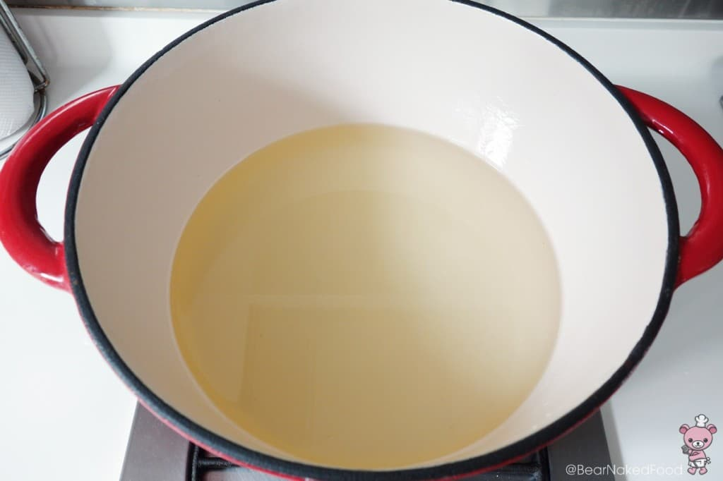 preparing dutch oven with oil to fry the churros