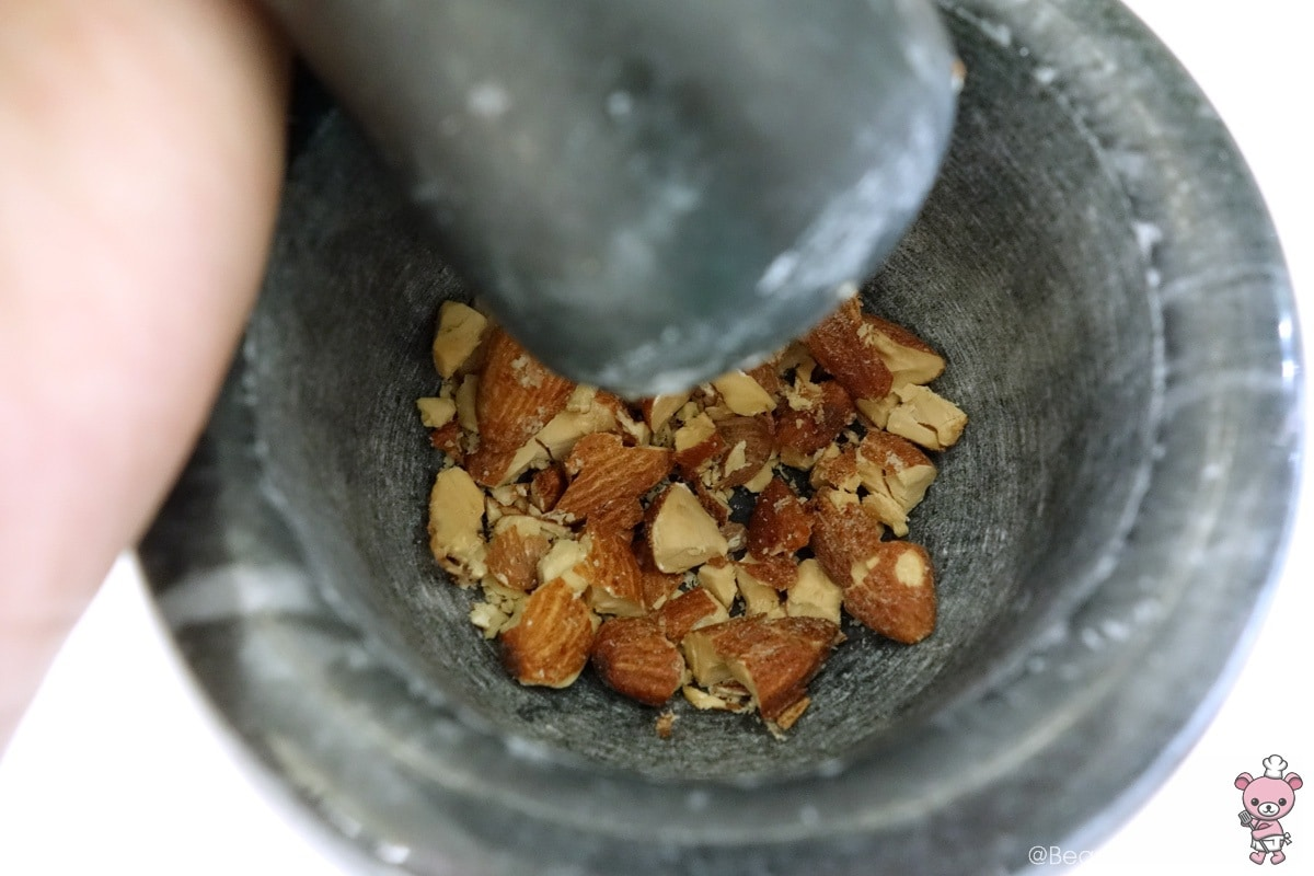 chopped almonds using a mortar and pestle