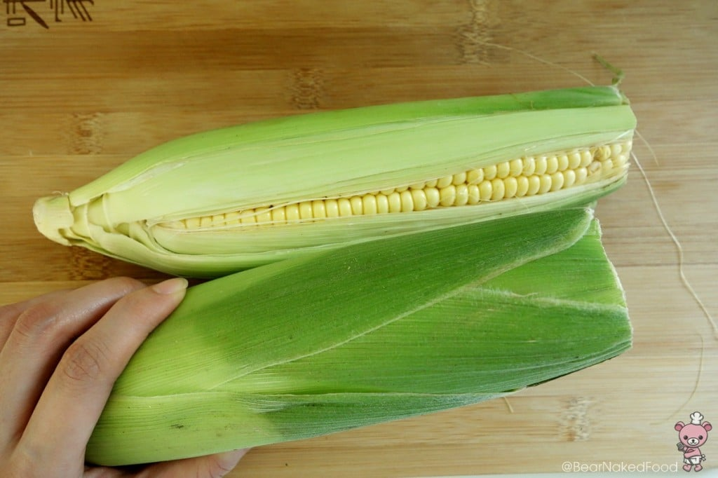 You do not need to clean or cut the corn. Leave it as it is.