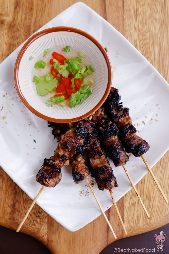 thai grilled pork skewers with spicy tangy dipping sauce