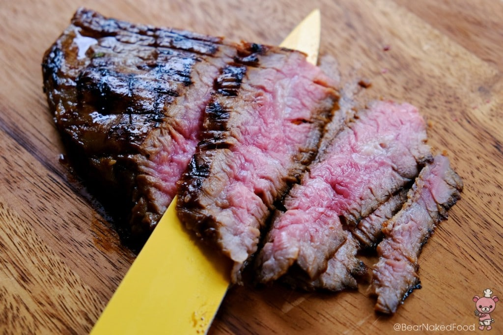 Asian grilled flank steak on a chopping board
