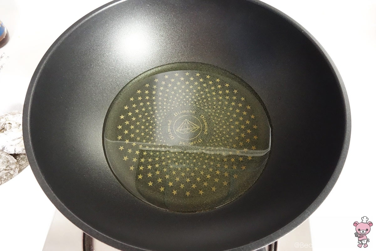Heat oil until smoking point. I'm using about 2 cups of vegetable oil.