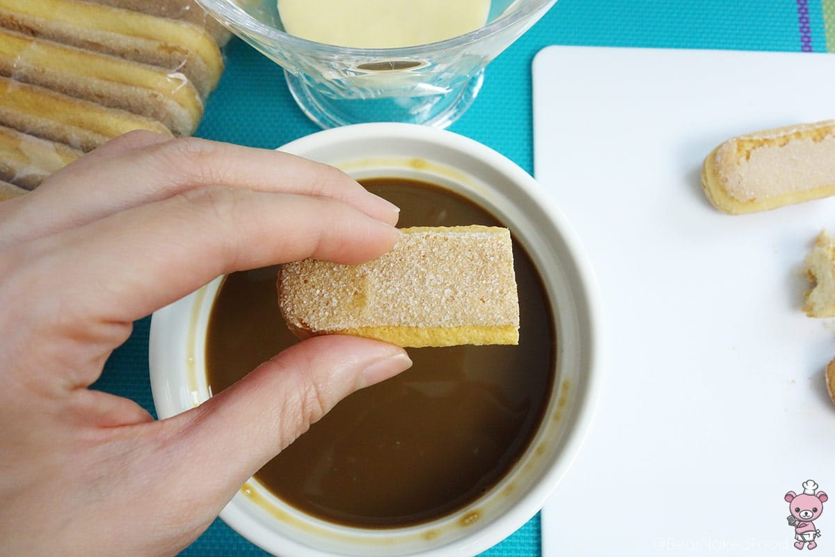 dipping ladyfingers into coffee
