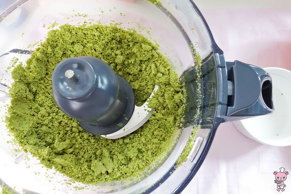 grinding green peas into powder
