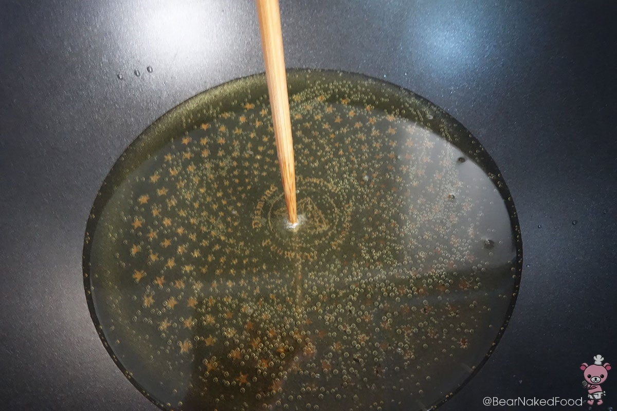 An old school way to test the heat of the oil -stick a chopstick in the middle of the pan. If it is bubbling, the oil is ready.