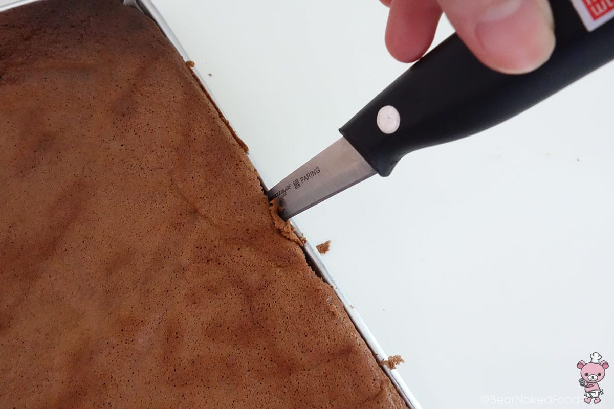 Use a thin knife to run around the edges and loosen the cake from the tray.