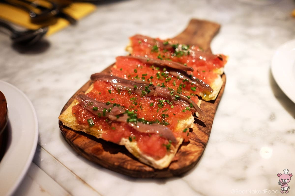Anchoas En Pan De Cristal (Smoked anchovy fillets on crystal bread, 4 pieces, $18)