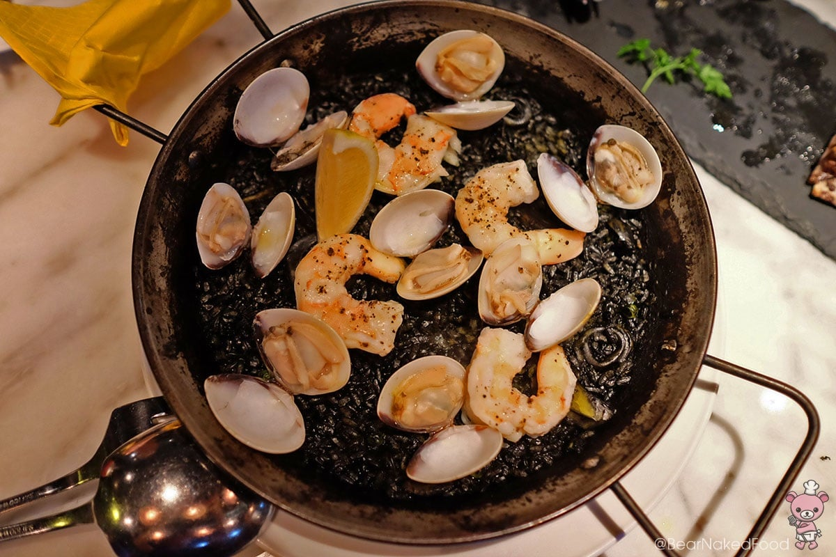 Paella Negra De Marisco (Squid ink seafood paella, regular size, $32)