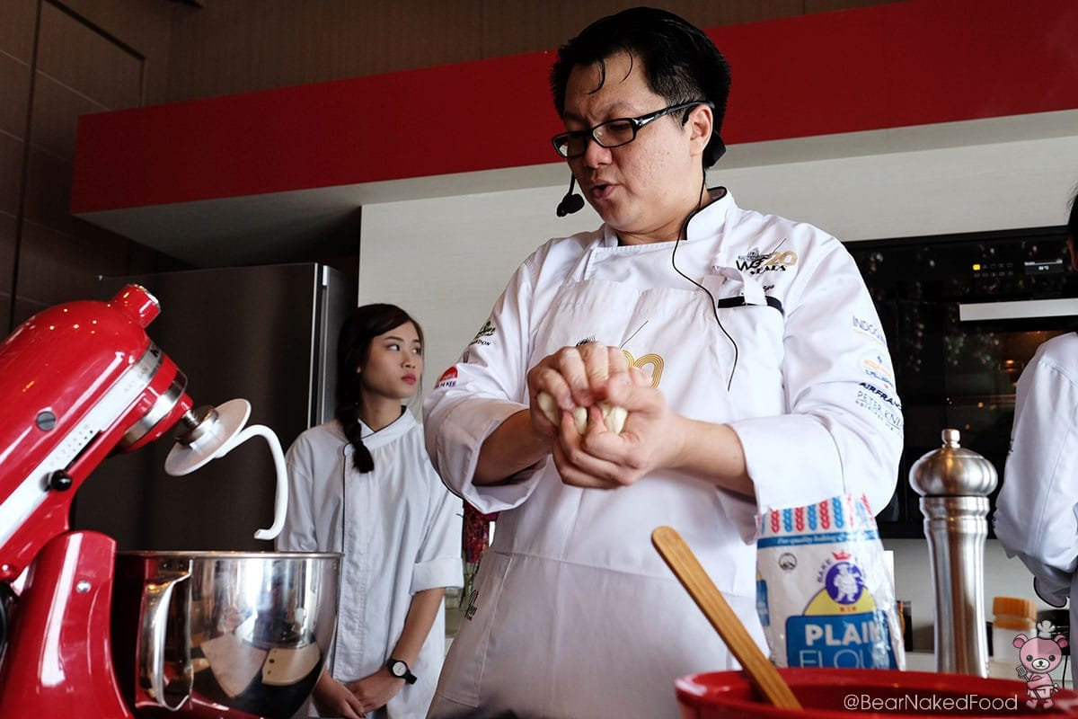Chef See demonstrated on making the dumpling dough.