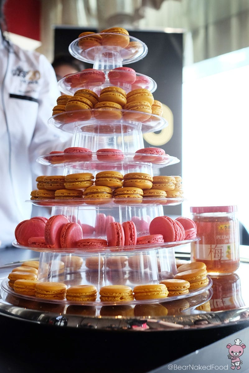 Stunning tower of French macarons with plum sauce filling.