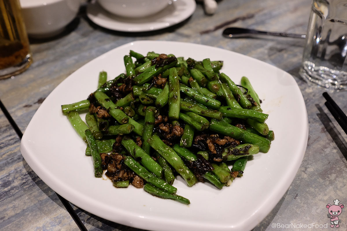 Stir fried French beans with pu er 四季普尔香 ($11.90).