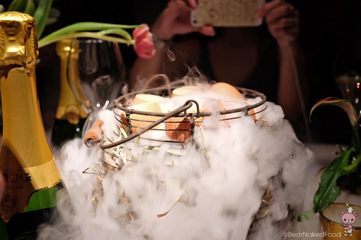 Th soft hens' eggs were serving sitting on a basket of dry ice.