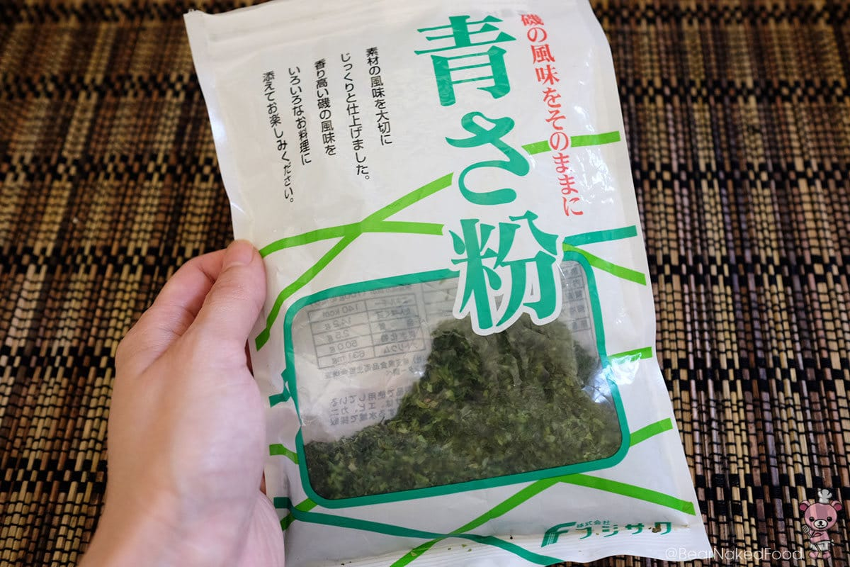 You can find aonori flakes / seaweed flakes in supermarkets.