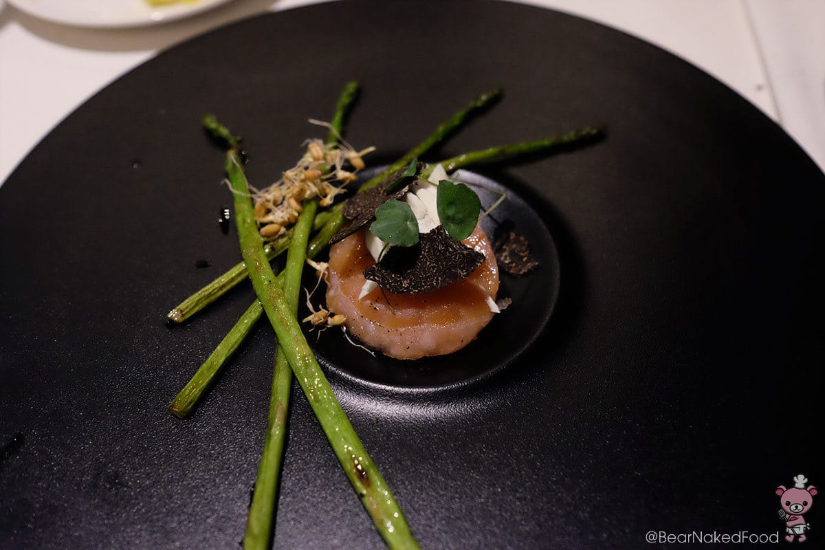 Loch Fyne salmon tartare wrapped in Corsican Valetta with wild asparagus, almond milk curd and black truffles