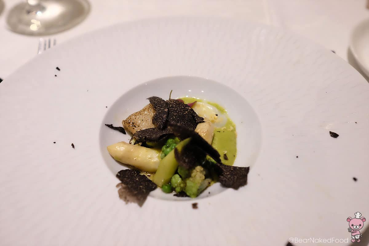 Smoked gnocchi with black truffles and summer greens