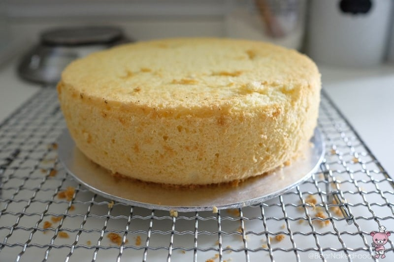 Turn the cake top side down before slicing so you will get a smooth top.