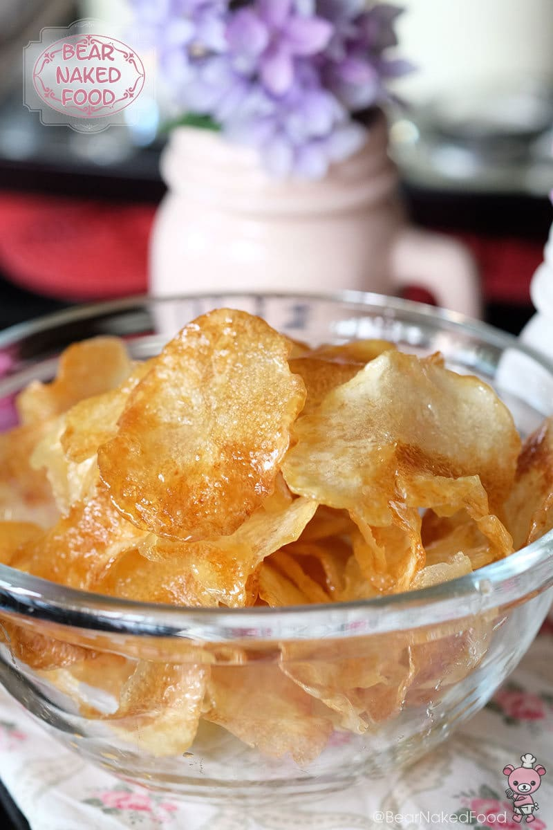 A side shot of a bowl of the Korean snack honey butter chips.
